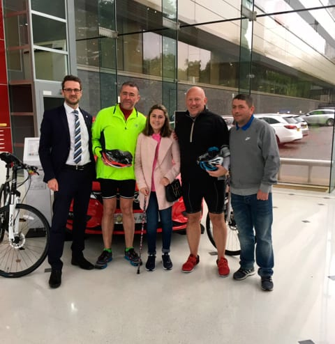 Dads arrive at Vauxhall Head office in Luton after cycling from Liverpool